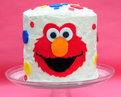 elmo birthday elmo birthday cake with a rainbow cake inside balancing