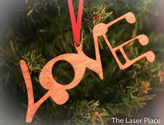 ornament made from symbols laser cut by thelaserplace