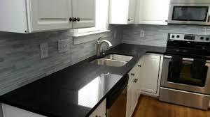 white kitchen cabinets with black quartz quartz countertops midnight black quartz