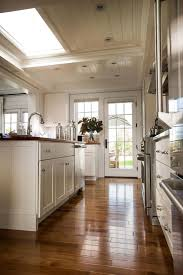 quartz countertops off white kitchen cabinets lighting flooring