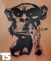 black smoking monkey tattoo design by robert franke