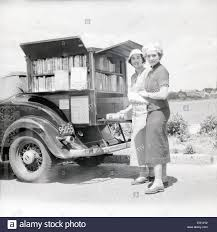 antique 1936 photograph traveling plymouth bookmobile car in cape