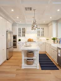 narrow kitchen with island a pair of polished nickel industrial pendants hang a narrow