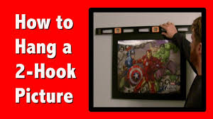 how to hang a picture frame how to hang a picture with 2 hooks youtube
