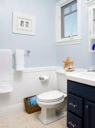 dark blue bathroom wall decor toilet in light brown tile wall