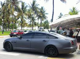 rick ross bentley wraith matte jaguar xj miami beach exotic cars on the streets of miami