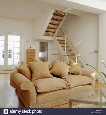 beige sofa in living area in loft conversion with open tread stock