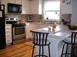 White Kitchen Cabinets With Black Island by Tutorial Painting Fake Wood Kitchen Cabinets