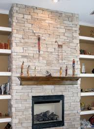 beforenafter a new gas fireplace with custom stone wall into