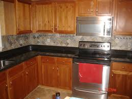 designer tiles for kitchen backsplash adorable interior woth wooden cabinet also sleek black countertop
