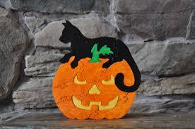 jack o lantern pumpkin with black cat halloween fall puzzle