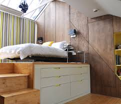sumptuous loft bed with desk underneath in bedroom contemporary