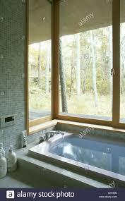 Japanese Bathroom by Bath Tub In A Japanese Bathroom With A Window Toward The Wood