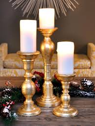 how to make gold leafed holiday candlesticks hgtv