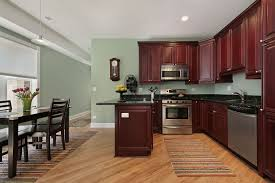 kitchen wall color green wall theme and dark red wooden kitchen cabinet added by brown