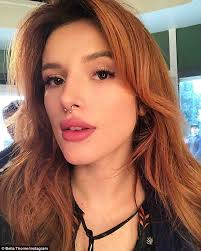 hair cor for 66 year old women bella thorne debuts eye popping red hair color in la daily mail