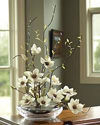 floral arrangements for dining room tables orchid tree centerpiece think this would be fab on my dining room