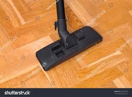 Vacuum Laminate Floors Vacuum Cleaner On Parquet Technology Housework Stock Photo