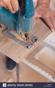 Saw For Cutting Laminate Flooring Installing Laminate Flooring Carpenter Cut Parquet Floor Board