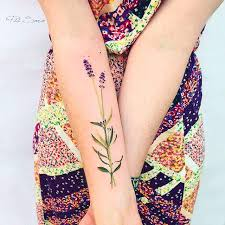 pretty minimalist flower stem tattoo by pis saro pissaro tattoo