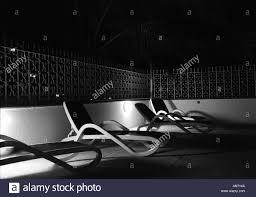 Pool At Night Beach Chairs At A Pool At Night Stock Photo Royalty Free Image