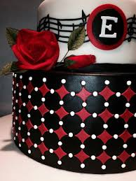 graduation cake with geometric pattern and gumpaste roses