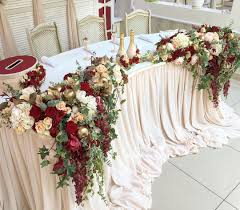mr and mrs head table decor design by feathered arrow