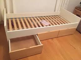 ikea brekke single bed frame with three wheeled underbed storage