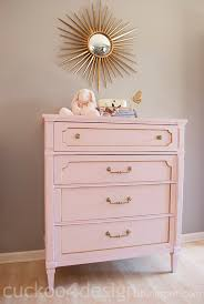 how to refinish an old dresser and add it to the nursery