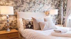 freshen up your bedroom with new paint or wallpaper mitre 10