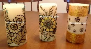 henna hand painting candles hennacurve