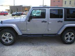 white jeep 4 door car pictures