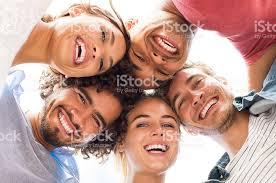 happy friends embracing stock photo 544350926 istock