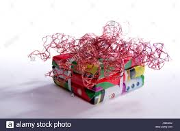 a pile of square christmas presents wrapped in festive red paper