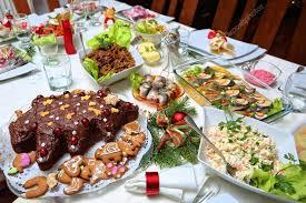 table full of food festive table full of food for christmas stock photo ambrozinio