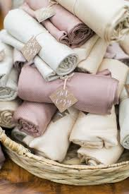 6 creative ways to display blankets for guests at a winter wedding