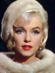how did marilyn monroe go from slightly hooded eyes to non hooded see here and here and
