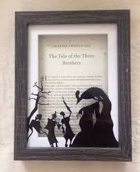harry potter framed deathly hallows design with tale of the