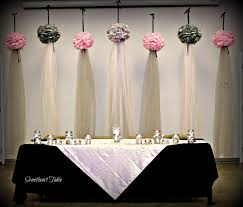 tulle backdrop floating pompoms with tulle draping made an unique beautiful