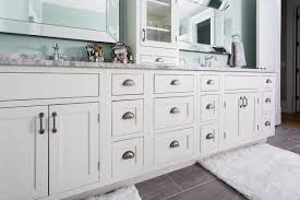 sconces flanking mirror bathroom farmhouse with inset cabinets