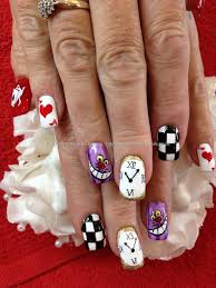 freehand alice in wonderland nail art this persons hands kinda