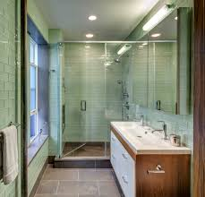 green glass subway tile bathroom midcentury with double faucets