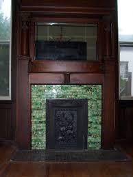 green mosaic tile fireplace surround plus wood mantel inside the
