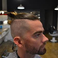 high and tight mid bald fade ninja bun on top haircut by prince