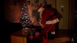 real santa caught on tape eating the christmas cookies and then