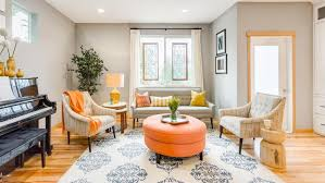 gray transitional living room with orange ottoman harmony weihs