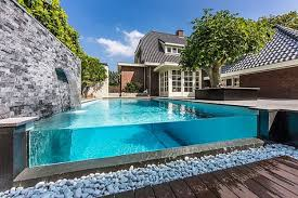 pool simple water curtain on stone wall and long pool in