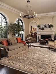 traditional living room ideas with floral printed carpet and round