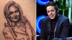 clinton responds to snl cast member u0027s tattoo of her face u0027i u0027m