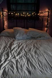 wrap christmas lights around headboard for a romantic look ideas